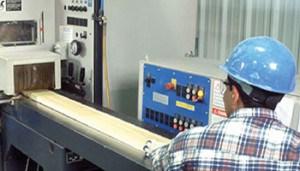Mill Worker cutting White Cedar