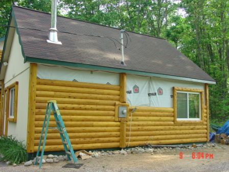 The history of the log cabin heartwood mills Pre cut homes