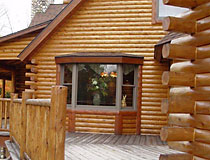 Glossary for log home builders heartwood mills for Log cabin butt and pass